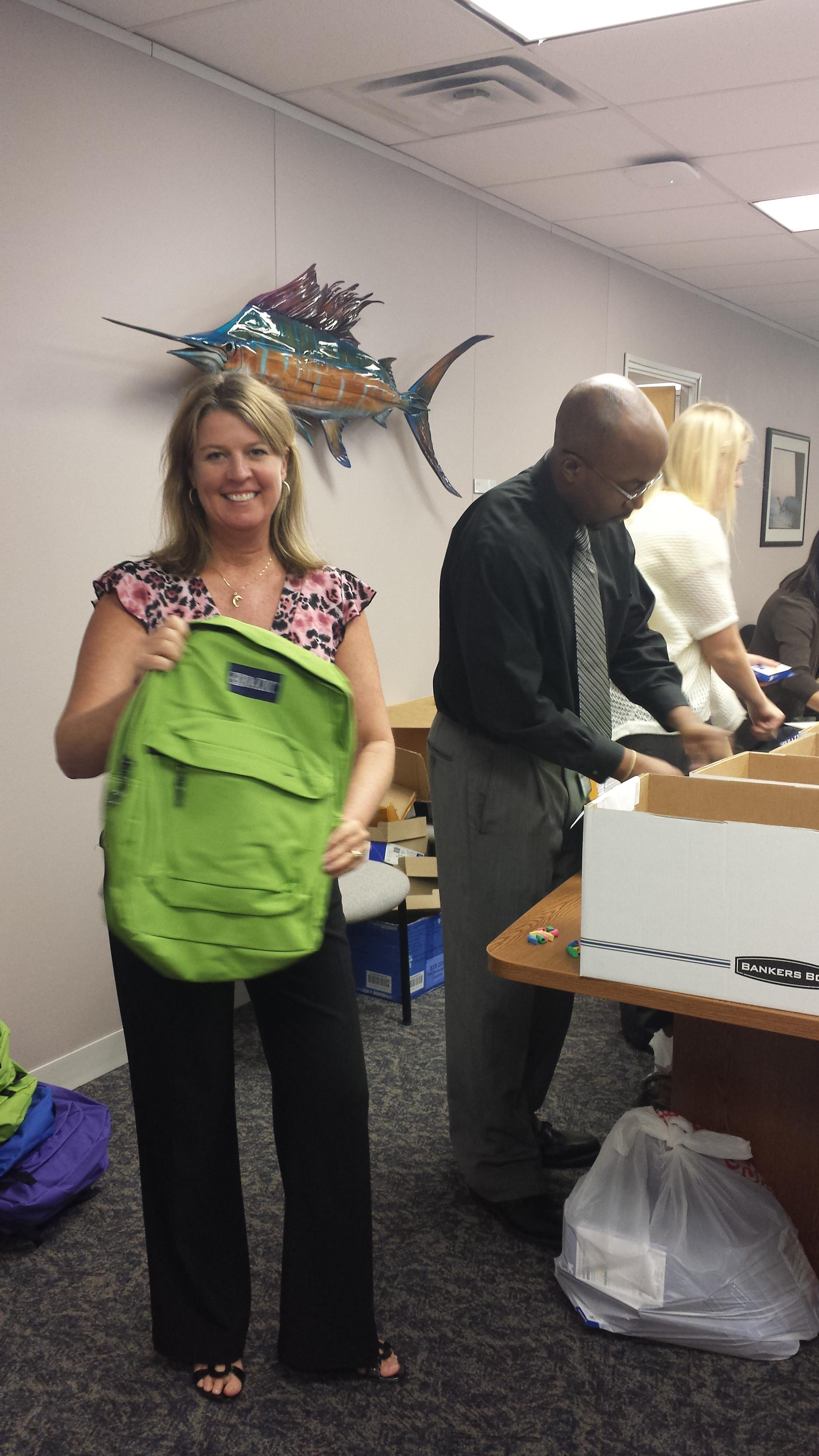 Josee volunteers to fill back packs for children in need