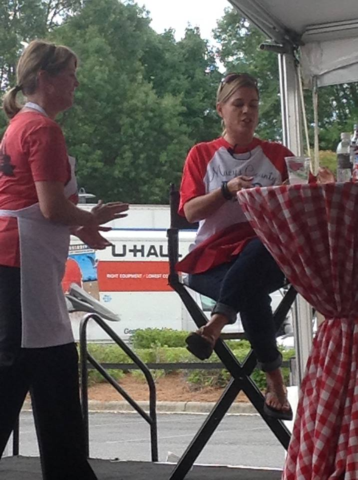 Me at the cook off explaining my dish to Cat Cora