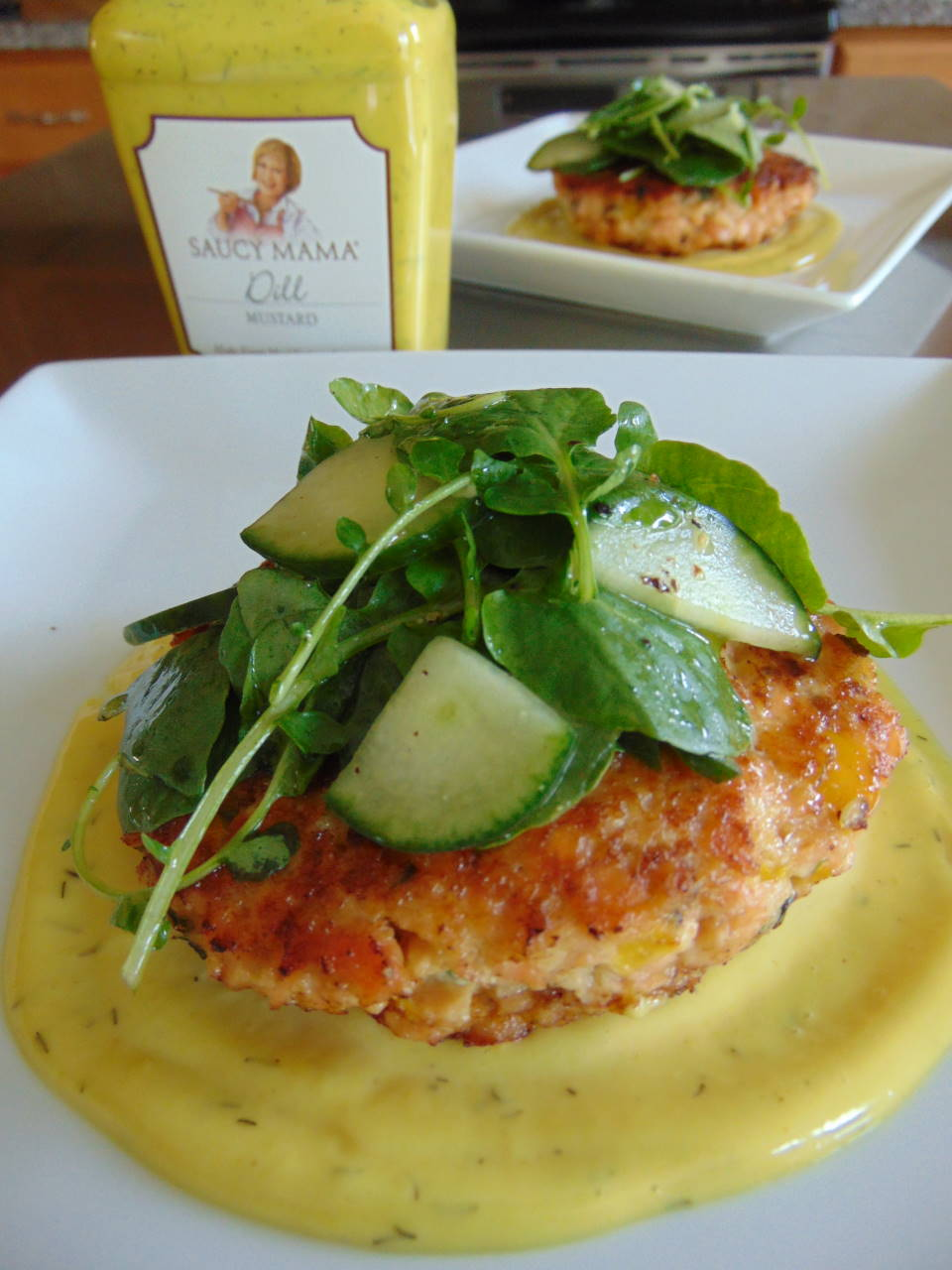Salmon Cakes over Mustard Dill Aioli with Cucumber Watercress Salad With Saucy mama s Dill mustard